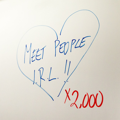 "Heart drawing with ""Meet People IRL!! x2,000"" written inside"