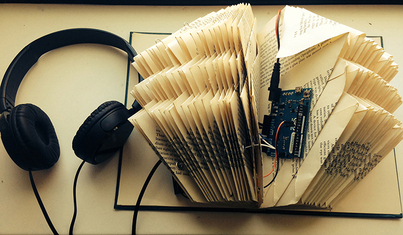 Codex book with Arduino components