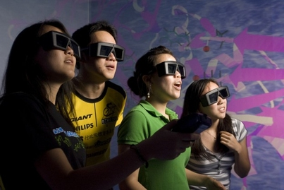 four people wearing virtual reality glasses