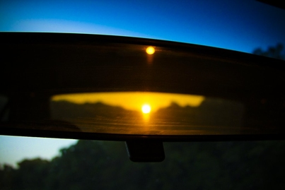 """061409: Rearview Sunset"" by Kim Jones. Photo of sunset in rearview mirror."