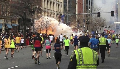 Image of Boston Marathon Bombing, billowing smoke, from final block of the race