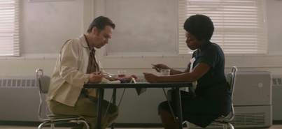 C.P. Eliis (Sam Rockwell) and Ann Atwater (Taraji P. Henson) are forced to sit together during a charette.