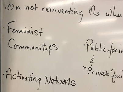 White board notes on building a feminist community