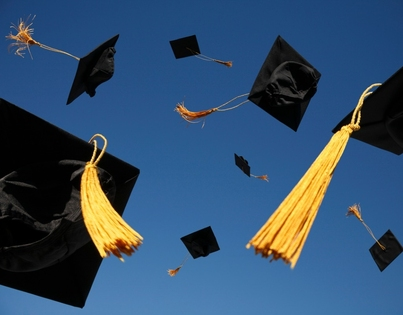 Mortarboard caps that have been thrown into the air