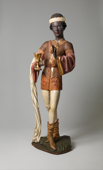 Image of sculptural figure depicting person of African descent in medieval clothing