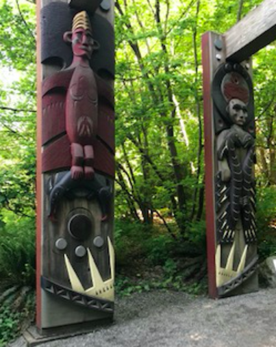 Photo of carved wooden Musqueam house poles
