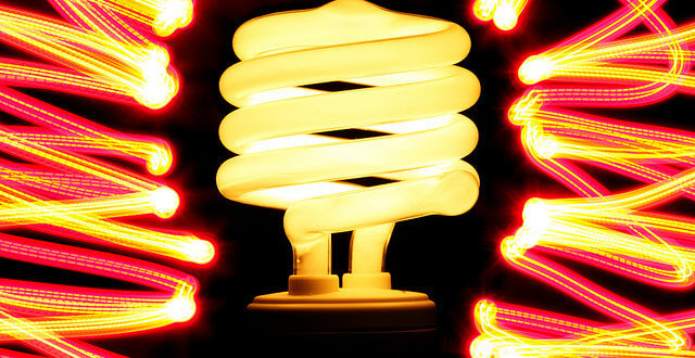 Photo of CFL bulb surrounded by yellow-orange swirls of light