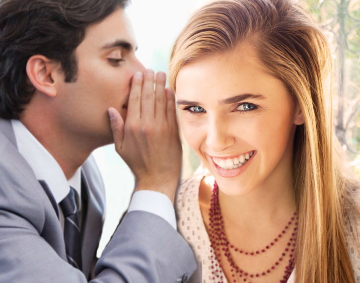 Man whispering rumour to a woman