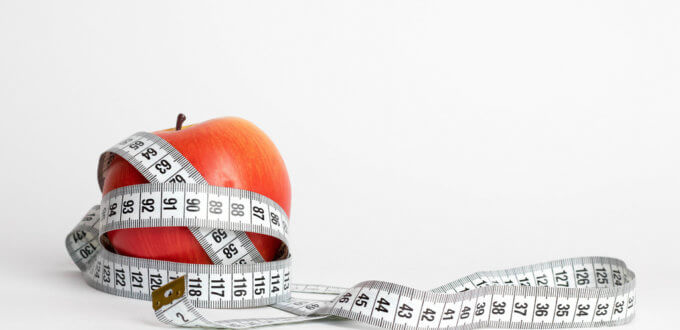 Red Apple wrapped with Tape Measure, CC BY 2.0 Marco Verch