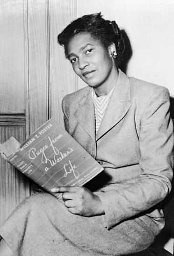 Photograph of Claudia Jones reading William Z. Foster's Pages from a Worker's Life (1939)