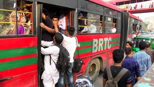 Crowded bus in Dhaka Road, People hanging on the bus door, Bangladeshi Public Bus