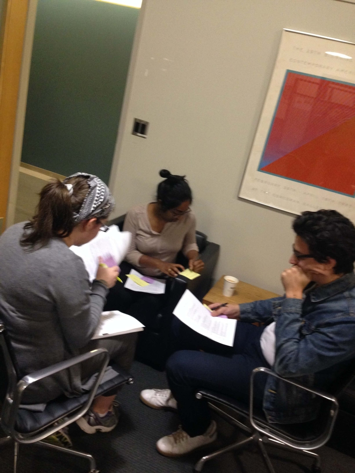 Three participants reviewing and discussing the CVs and Cover Letters.