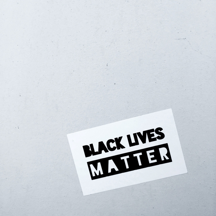 "Black and white stylized text reading ""Black Lives Matter"""