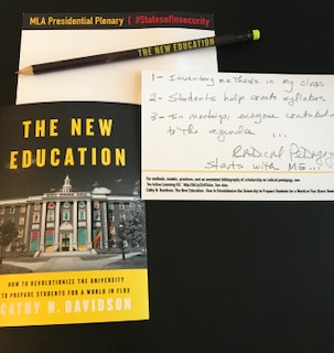 Notecards, pencil, and copy of The New Education by Cathy Davidson