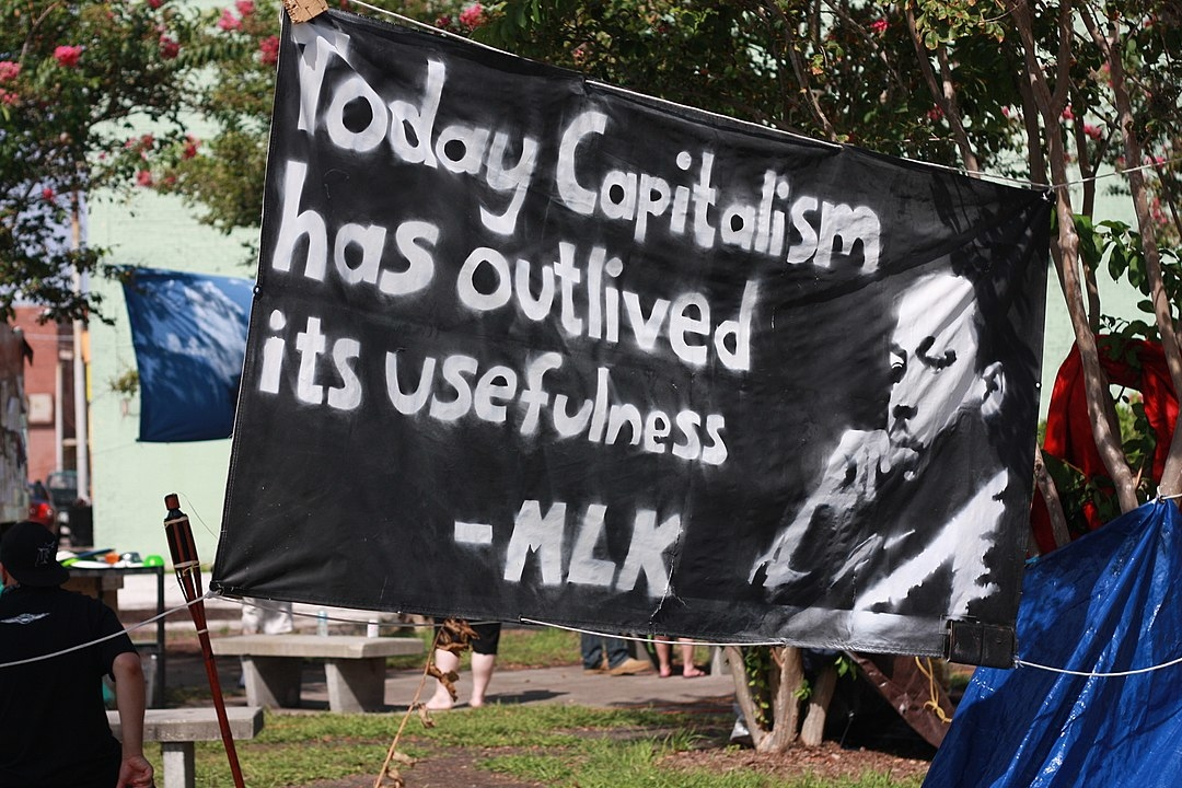By Liz Mc - Flickr: 'Today capitalism has outlived its usefulness' MLK, CC BY 2.0, https://commons.wikimedia.org/w/index.php?curid=20987101